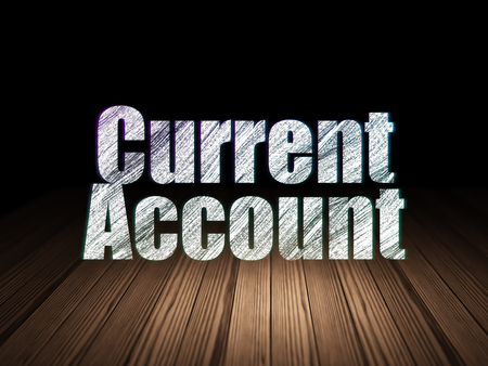 current account: Currency concept: Glowing text Current Account in grunge dark room with Wooden Floor, black background Stock Photo