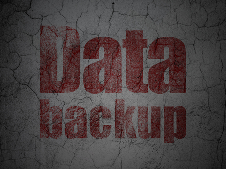data backup: Data concept: Red Data Backup on grunge textured concrete wall background Stock Photo
