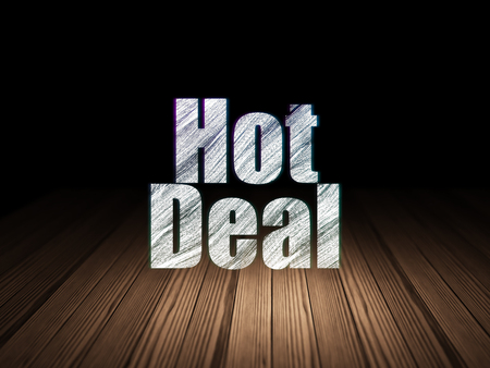 deal in: Finance concept: Glowing text Hot Deal in grunge dark room with Wooden Floor, black background Stock Photo
