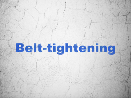 tightening: Business concept: Blue Belt-tightening on textured concrete wall background