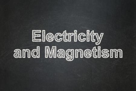 magnetismo: Concepto de la ciencia: Electricidad y Magnetismo de texto en el fondo pizarra Negro