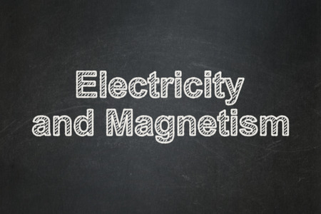 magnetism: Science concept: text Electricity And Magnetism on Black chalkboard background Stock Photo