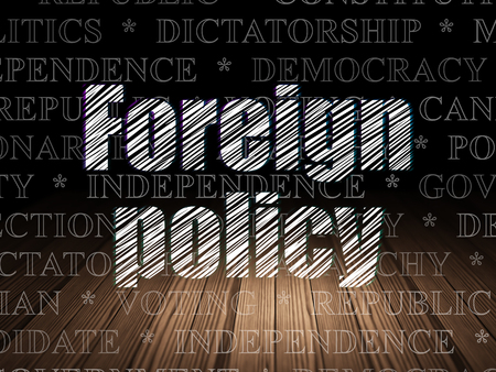 foreign policy: Politics concept: Glowing text Foreign Policy in grunge dark room with Wooden Floor, black background with  Tag Cloud