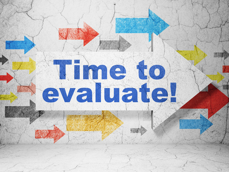 evaluate: Time concept:  arrow with Time to Evaluate! on grunge textured concrete wall background, 3D rendering