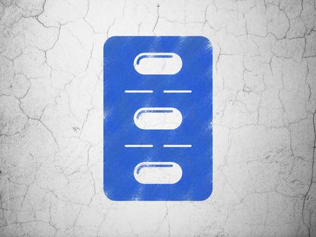 blue pills: Medicine concept: Blue Pills Blister on textured concrete wall background