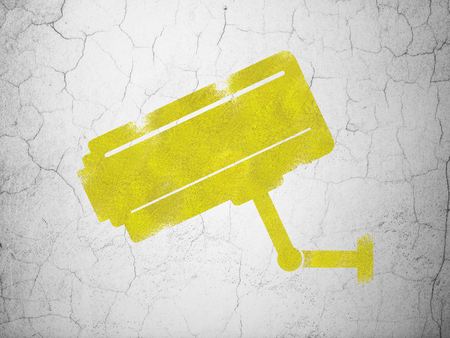 video wall: Privacy concept: Yellow Cctv Camera on textured concrete wall background