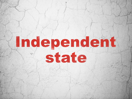 dictatorship: Politics concept: Red Independent State on textured concrete wall background