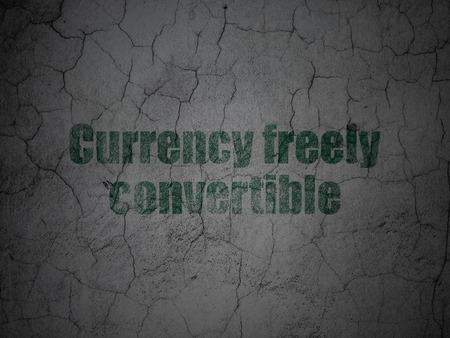 freely: Currency concept: Green Currency freely Convertible on grunge textured concrete wall background Stock Photo