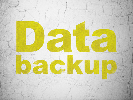 data backup: Information concept: Yellow Data Backup on textured concrete wall background