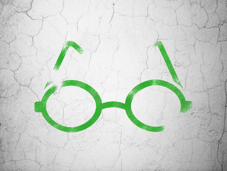 green glasses: Science concept: Green Glasses on textured concrete wall background