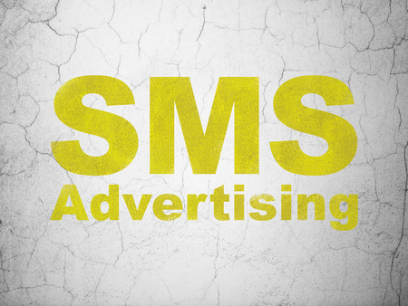 sms: Marketing concept: Yellow SMS Advertising on textured concrete wall background Stock Photo