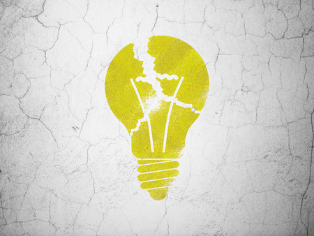 broken strategy: Business concept: Yellow Light Bulb on textured concrete wall background Stock Photo