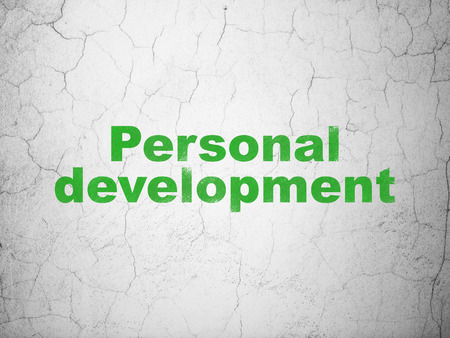 personal development: Learning concept: Green Personal Development on textured concrete wall background