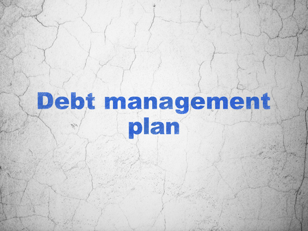 debt management: Finance concept: Blue Debt Management Plan on textured concrete wall background