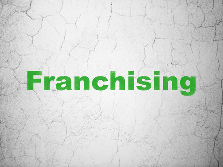 franchising: Business concept: Green Franchising on textured concrete wall background