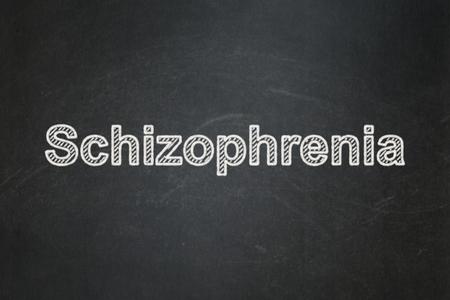 esquizofrenia: el concepto de salud: La esquizofrenia texto sobre fondo de pizarra Negro