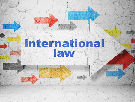 international law: Political concept:  arrow with International Law on grunge textured concrete wall background, 3D rendering