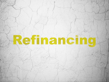 refinancing: Business concept: Yellow Refinancing on textured concrete wall background