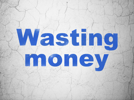 wasting: Banking concept: Blue Wasting Money on textured concrete wall background