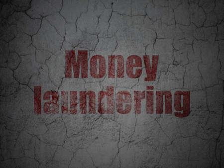 laundering: Money concept: Red Money Laundering on grunge textured concrete wall background