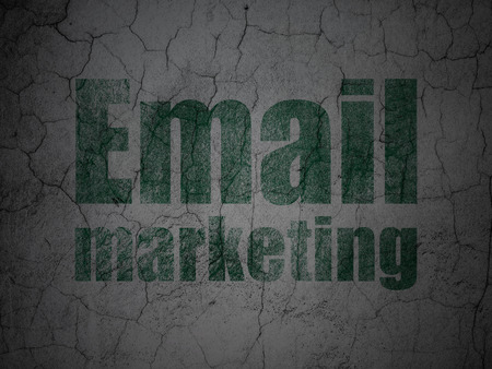 grungy email: Business concept: Green Email Marketing on grunge textured concrete wall background