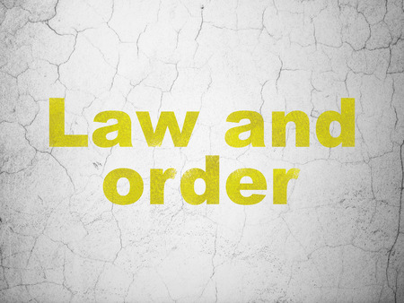 law and order: Law concept: Yellow Law And Order on textured concrete wall background