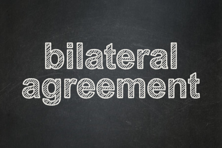 bilateral: Insurance concept: text Bilateral Agreement on Black chalkboard background