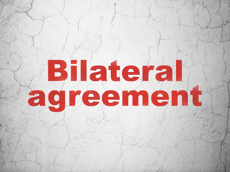 bilateral: Insurance concept: Red Bilateral Agreement on textured concrete wall background