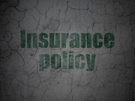 insurance policy: Insurance concept: Green Insurance Policy on grunge textured concrete wall background Stock Photo