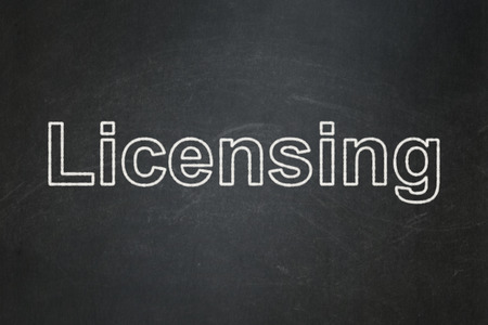 licensing: Law concept: text Licensing on Black chalkboard background