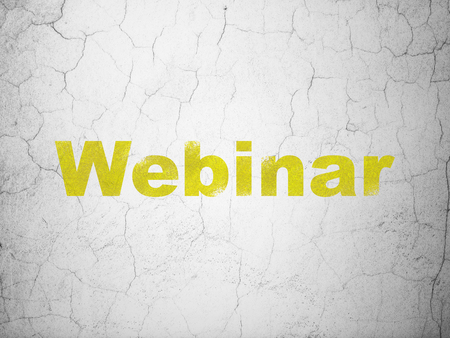information age: Studying concept: Yellow Webinar on textured concrete wall background