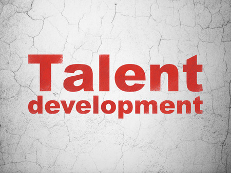 information age: Studying concept: Red Talent Development on textured concrete wall background