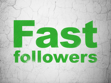 followers: Business concept: Green Fast Followers on textured concrete wall background Stock Photo