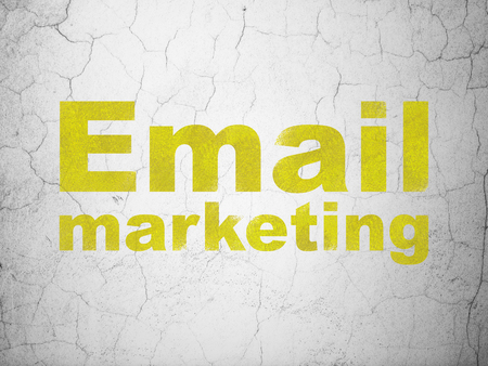 grungy email: Finance concept: Yellow Email Marketing on textured concrete wall background Stock Photo