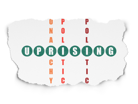 uprising: Political concept: Painted green word Uprising in solving Crossword Puzzle on Torn Paper background