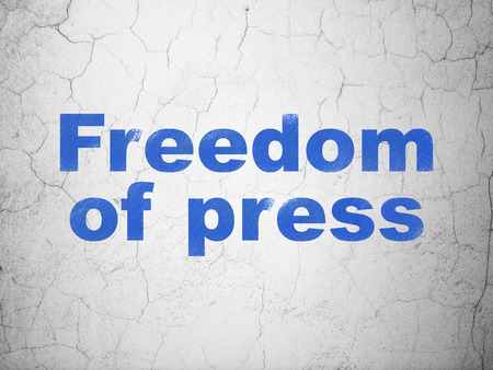 dictatorship: Political concept: Blue Freedom Of Press on textured concrete wall background
