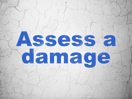 damage: Insurance concept: Blue Assess A Damage on textured concrete wall background Stock Photo