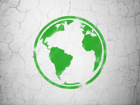 green globe: Science concept: Green Globe on textured concrete wall background