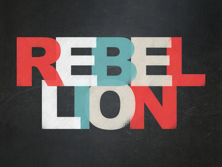 rebellion: Political concept: Painted multicolor text Rebellion on School board background, School Board