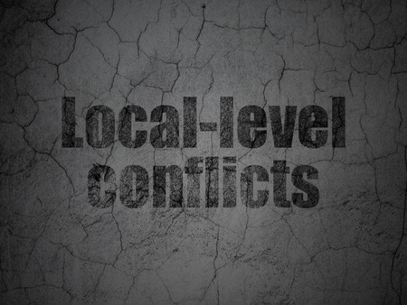 dictatorship: Political concept: Black Local-level Conflicts on grunge textured concrete wall background Stock Photo