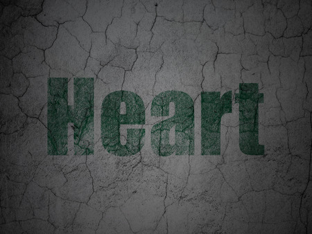 green heart: Healthcare concept: Green Heart on grunge textured concrete wall background