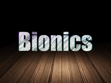 bionics: Science concept: Glowing text Bionics in grunge dark room with Wooden Floor, black background