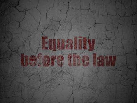 before: Political concept: Red Equality Before The Law on grunge textured concrete wall background