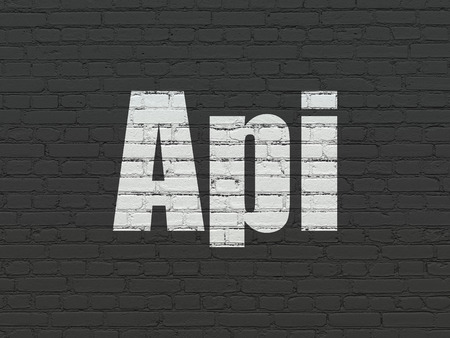 api: Programming concept: Painted white text Api on Black Brick wall background Stock Photo