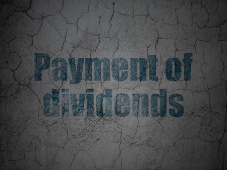 dividends: Money concept: Blue Payment Of Dividends on grunge textured concrete wall background