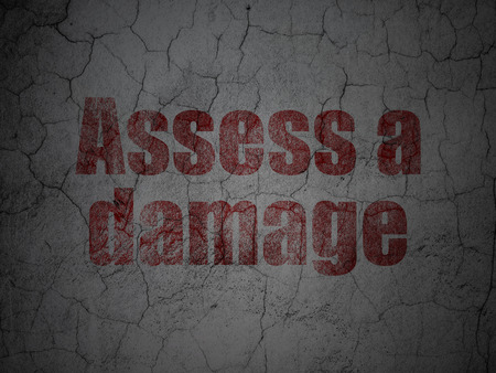 assess: Insurance concept: Red Assess A Damage on grunge textured concrete wall background