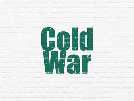 cold war: Politics concept: Painted green text Cold War on White Brick wall background Stock Photo