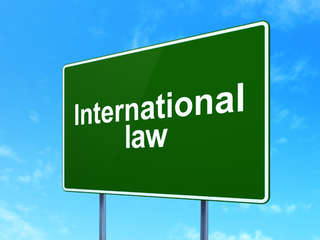 international law: Politics concept: International Law on green road highway sign, clear blue sky background, 3D rendering Stock Photo