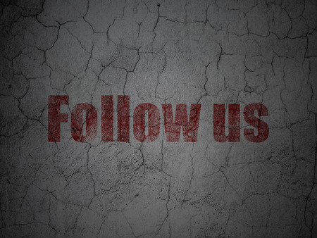 microblog: Social network concept: Red Follow us on grunge textured concrete wall background