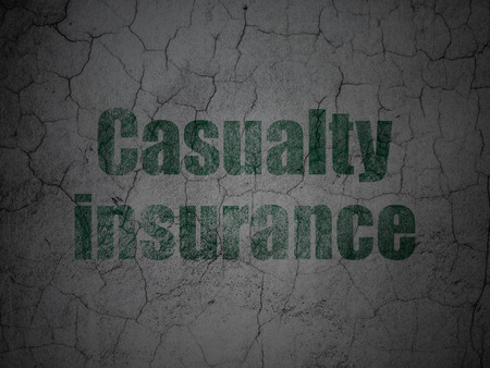casualty: Insurance concept: Green Casualty Insurance on grunge textured concrete wall background